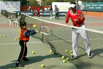 Sania Mirza coaches a kid on the opening day of the ABN AMRO Tennis Challenge