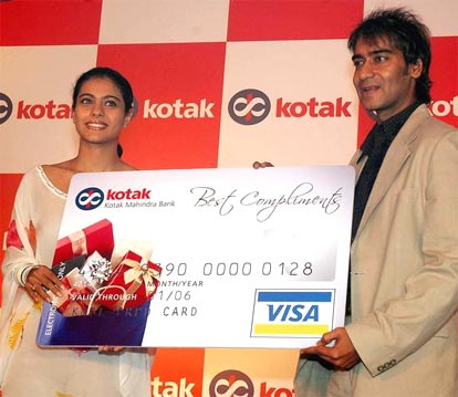 "Ajay Devgan presents his wife and cine actress Kajol with Kotak's ""best compliments "" card on her birthday."