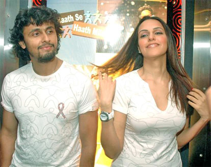Singer Sonu Nigam and actress Neha Dhupia at an AIDS awareness event on Saturday night