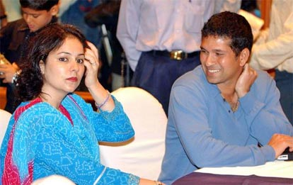 Sachin Tendulkar with his wife Anjali during a promotional event of a two wheeler company.