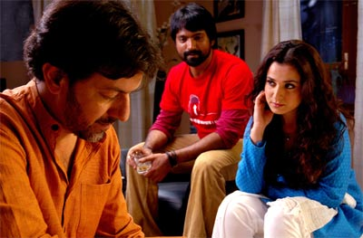 Rajat Kapoor, Prashanth Narayannan and Simone Singh in a still from the movie Via Darjeeling