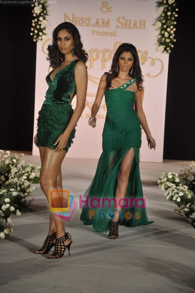 walks the ramp for Neelam and Nriti Shah on 1st April 2010