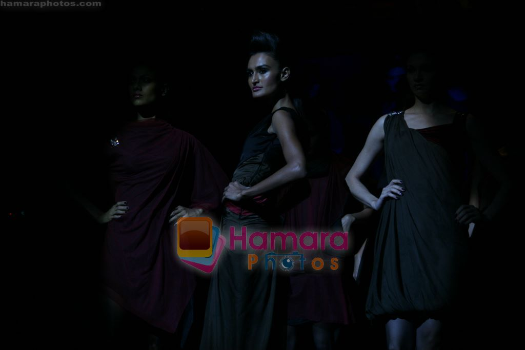 Model walks the ramp for Arjun Show at Lakme Winter fashion week day 4 on 20th Sept 2010