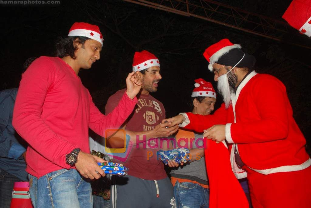 John Abraham, Ritesh Deshmukh spend christmas with children of St Catherines in Andheri on 25th Dec 2010