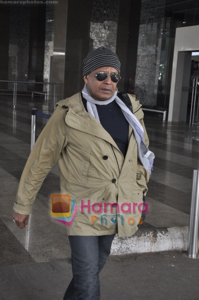 Mithun Chakraborty spotted at airport in Mumbai Airport on 14th Jan 2011