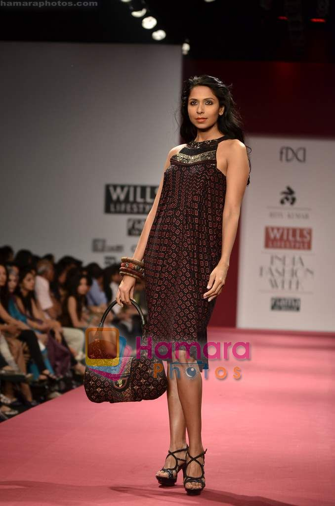 Model walks the ramp for Ritu Kumar show on Wills Lifestyle India Fashion Week 2011 - Day 2 in Delhi on 7th April 2011