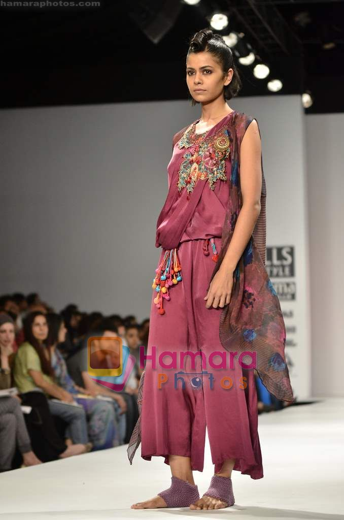 Model walks the ramp for Monapali show on Wills Lifestyle India Fashion Week 2011 - Day 1 in Delhi on 6th April 2011