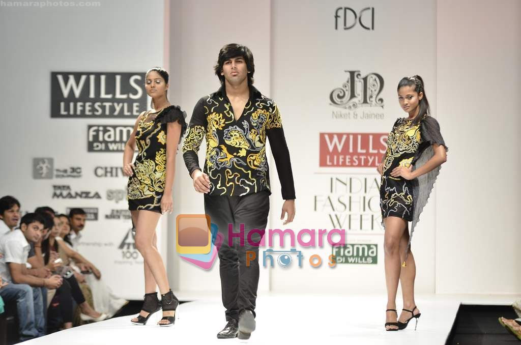 Model walks the ramp for Niket and Jainee show on Wills Lifestyle India Fashion Week 2011-Day 4 in Delhi on 9th April 2011