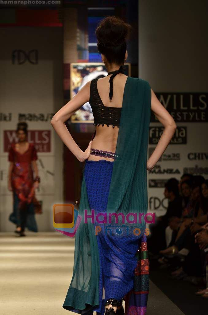 Model walks the ramp for Niki Mahajan show on Wills Lifestyle India Fashion Week 2011-Day 4 in Delhi on 9th April 2011