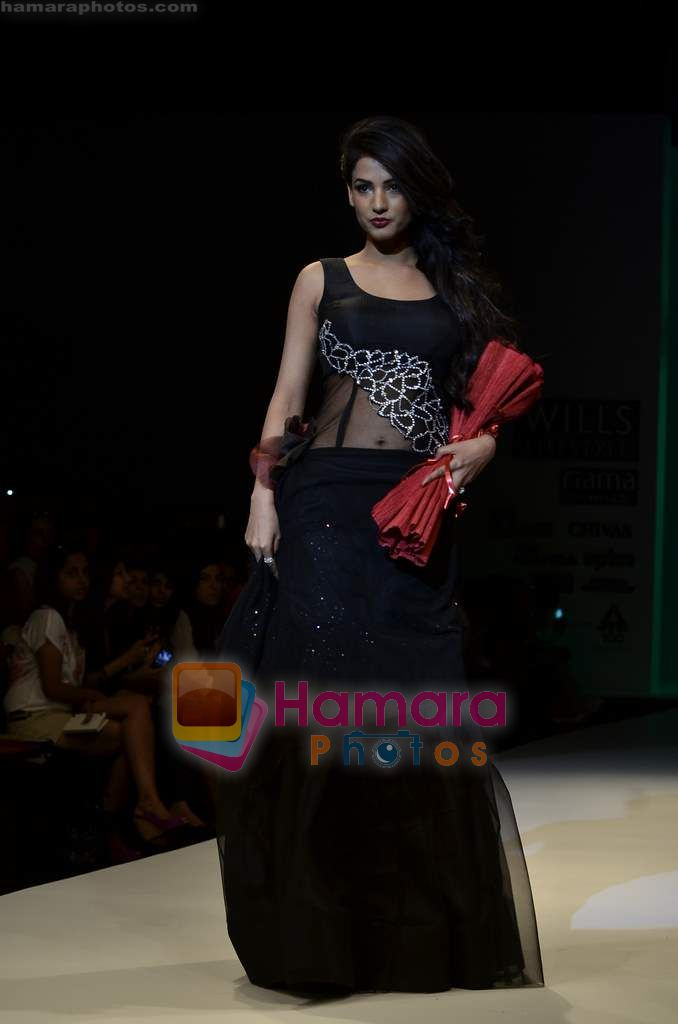 Sonal Chauhan walks the ramp for Sylph By Sadan show on Wills Lifestyle India Fashion Week 2011-Day 4 in Delhi on 9th April 2011