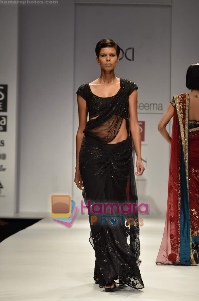 Model walks the ramp for Swapan and Seema show on Wills Lifestyle India Fashion Week 2011-Day 5 in Delhi on 10th April 2011