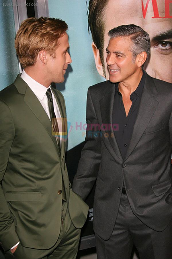 Ryan Gosling and George Clooney attends the The Ides of March Los Angeles Premiere in AMPAS Samuel Goldwyn Theater on 27th September 2011