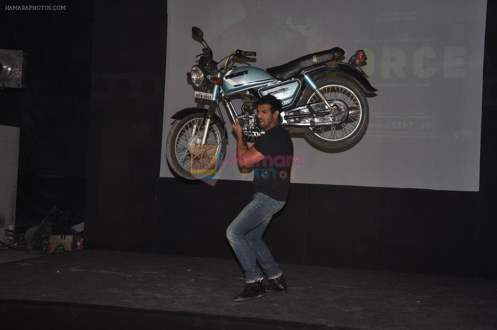 John abraham lifts a bike at Force Promotions in Mehboob, Mumbai on 27th Sep 2011