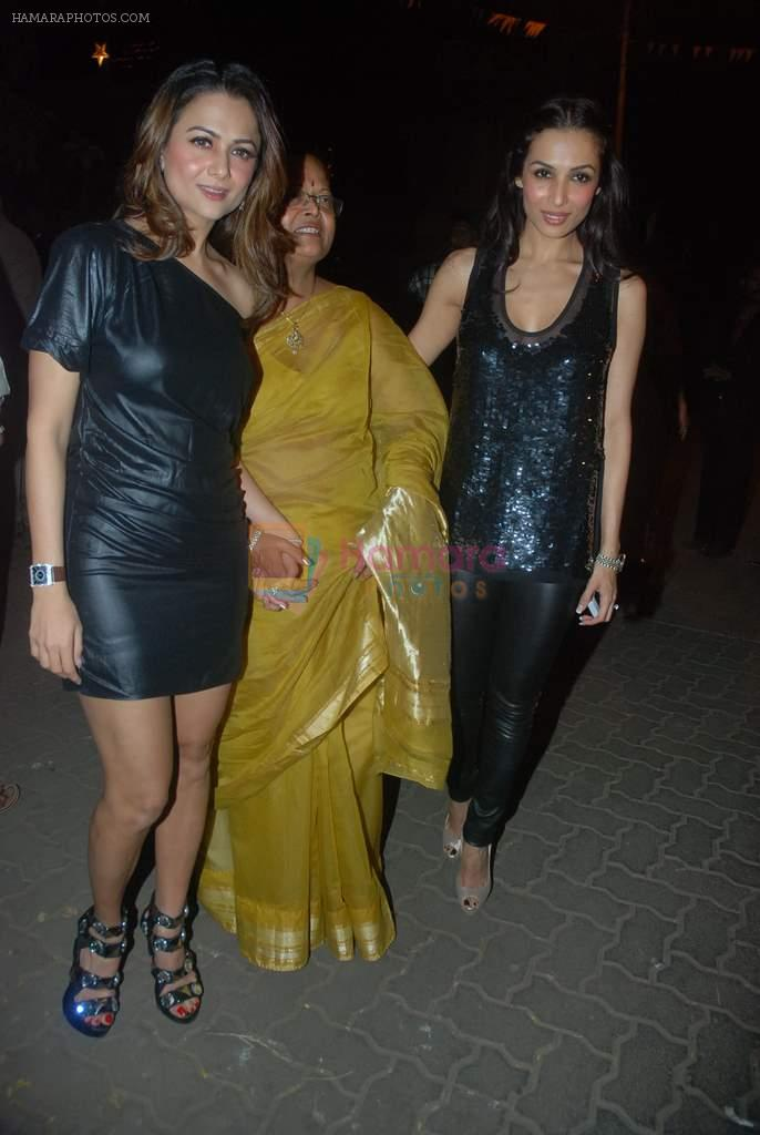 Amrita Arora, Malaika Arora Khan at Midnight mass in Bandra, Mumbai on 24th Dec 2011