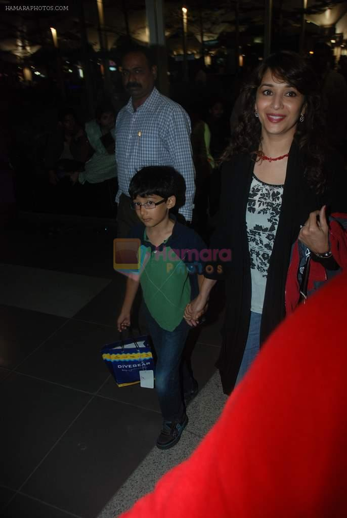 Madhuri Dixit snapped with kids and husband at the airport in Mumbai on 1st Jan 2012