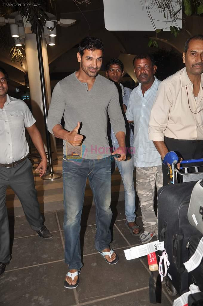 John Abraham snapped at the airport in Mumbai on 4th Jan 2012