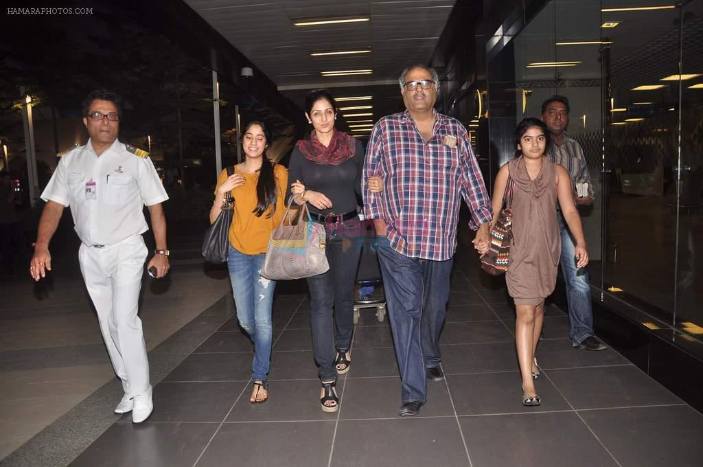 Sridevi, Boney Kapoor with Kids snapped at the airport in Mumbai on 4th Jan 2012