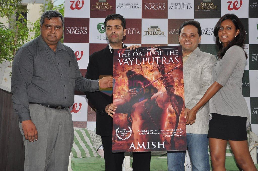 Karan Johar launches the Cover of Amish's eagerly anticipated 3rd book in the Shiva Trilogy, The Oath of the Vayuputras in Mumbai on 27th Dec 2012