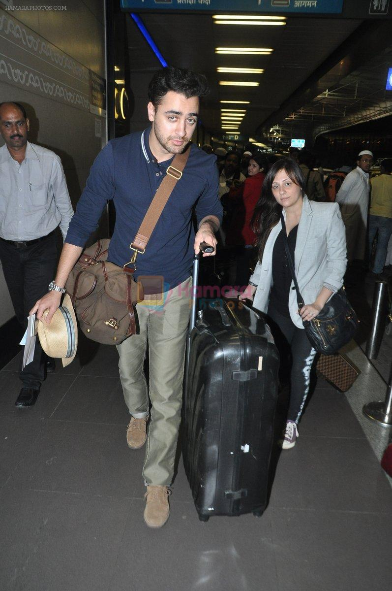 Imran Khan and Avantika Malik leave for new years vacation in Mumbai Airport on 25th Dec 2013