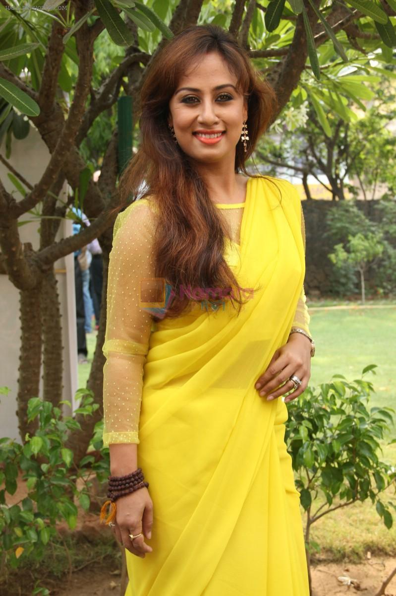 Maanu Actress New Stills in Yellow Sari