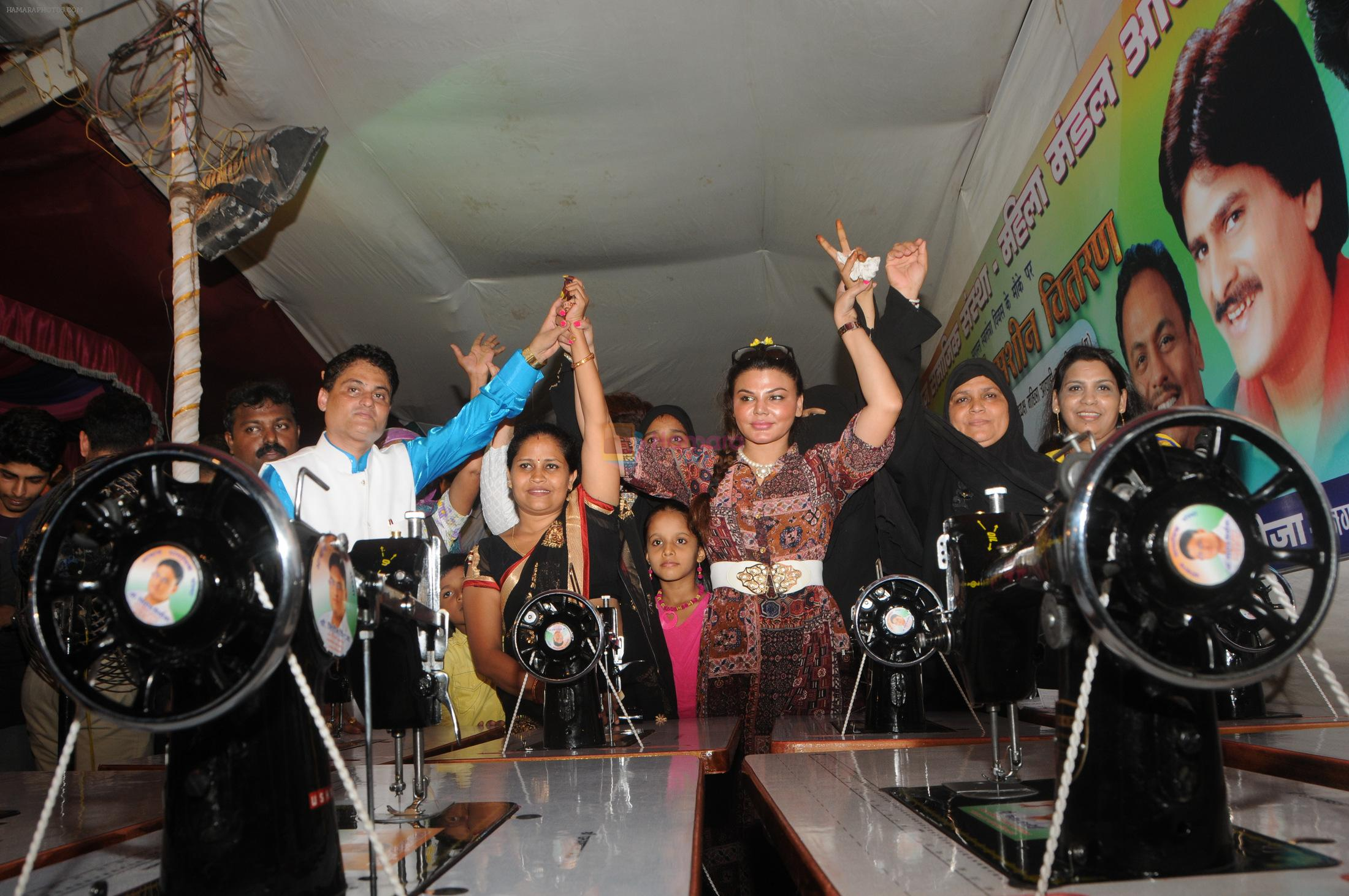 Cyril Dsouza with Rakhi Sawantand Zeenat Qureshi  Distributing Sewing Machines