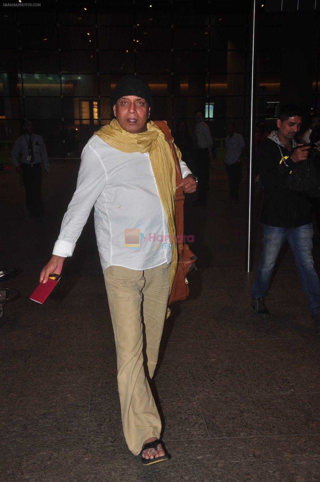 Mithun Chakraborty snapped at airport in Mumbai on 2nd Jan 2015
