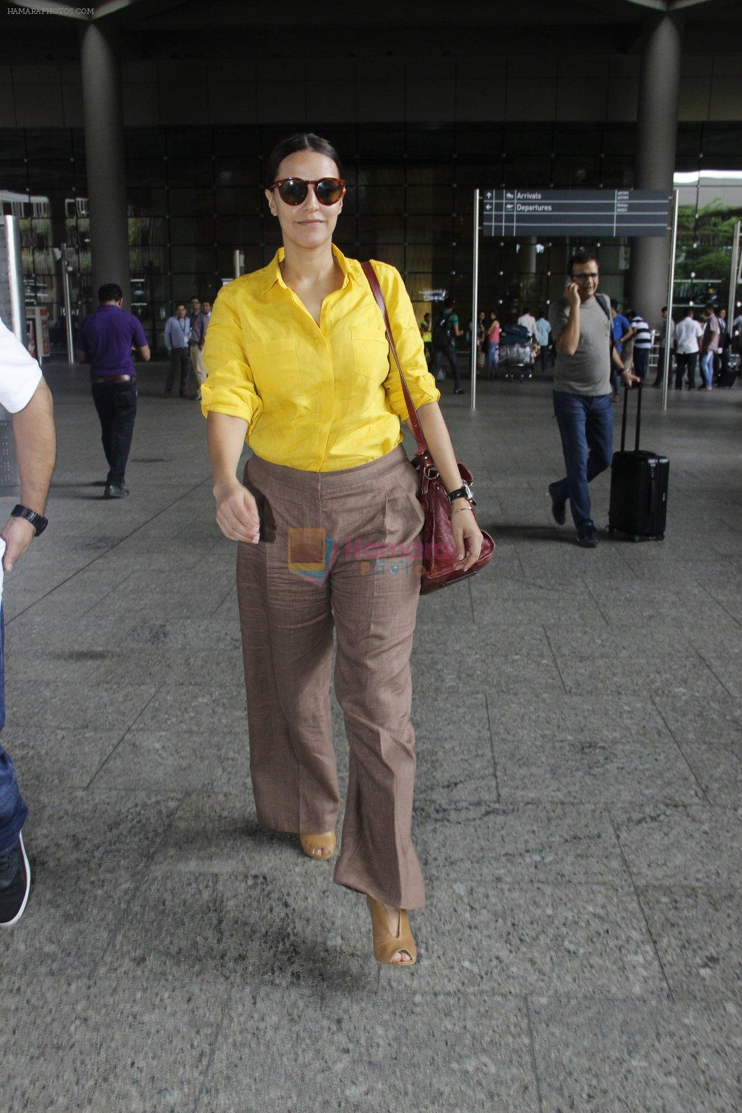 Neha Dhupia snapped at airport on 25th July 2016