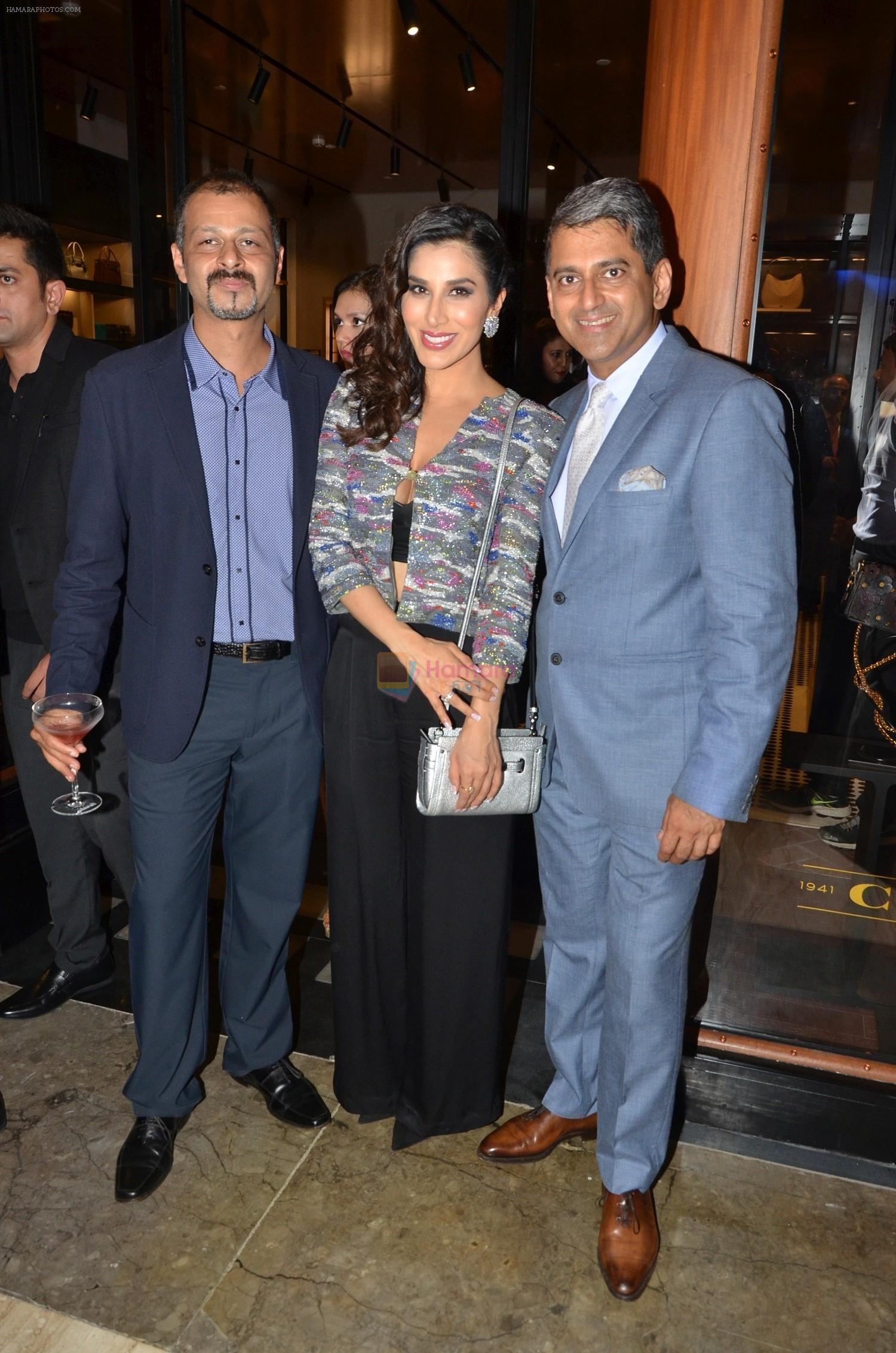 Atul Ruia, Sophie Choudry And Sanjay Kapoor At The Coach Launch Celebrations