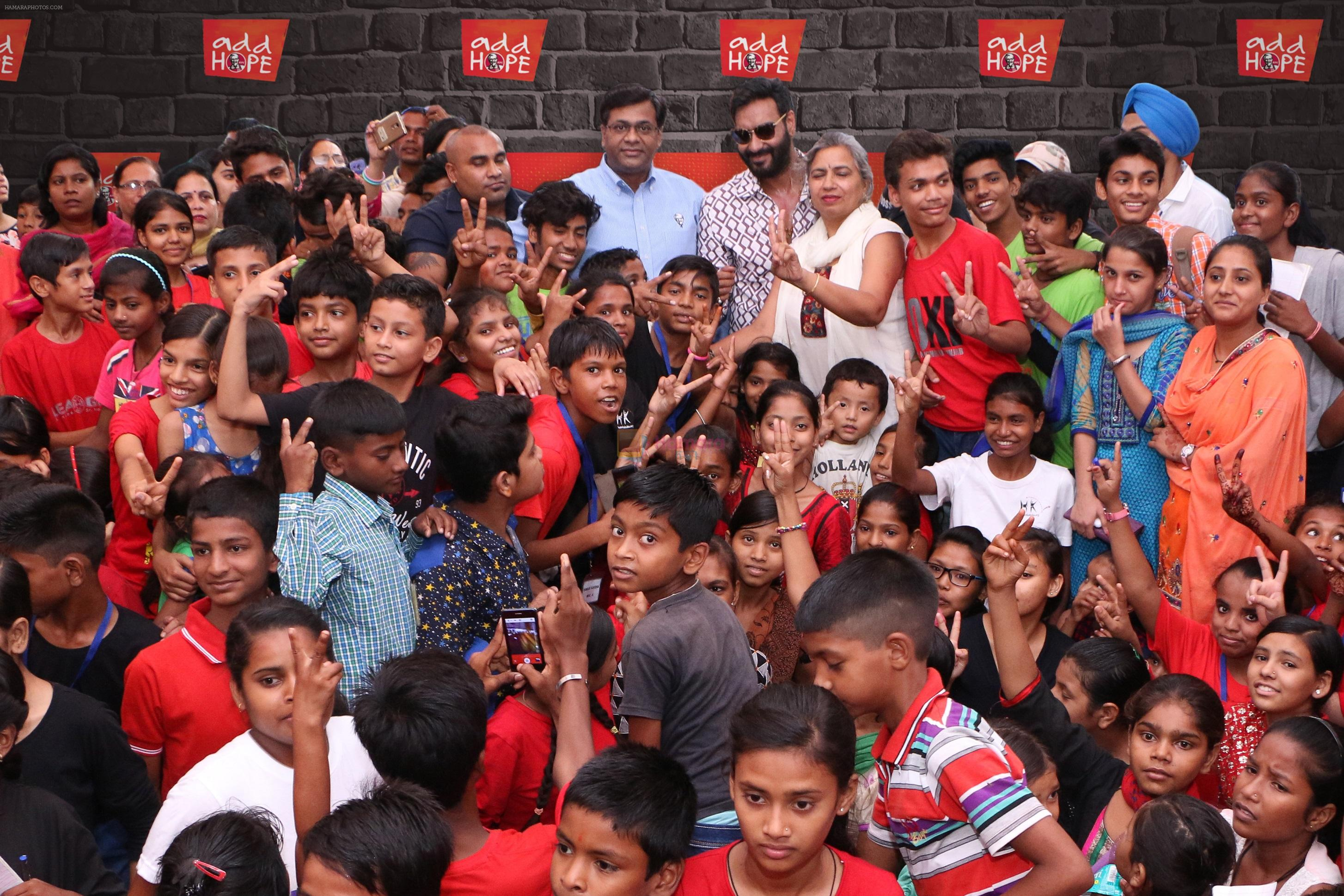 Praveen Reddy, Director, Restaurant Excellence and Area Countries, KFC India and Hope ambassador Ajay Devgn with kids at Hamaari Kaksha during add HOPE event in Chandigarh - Copy