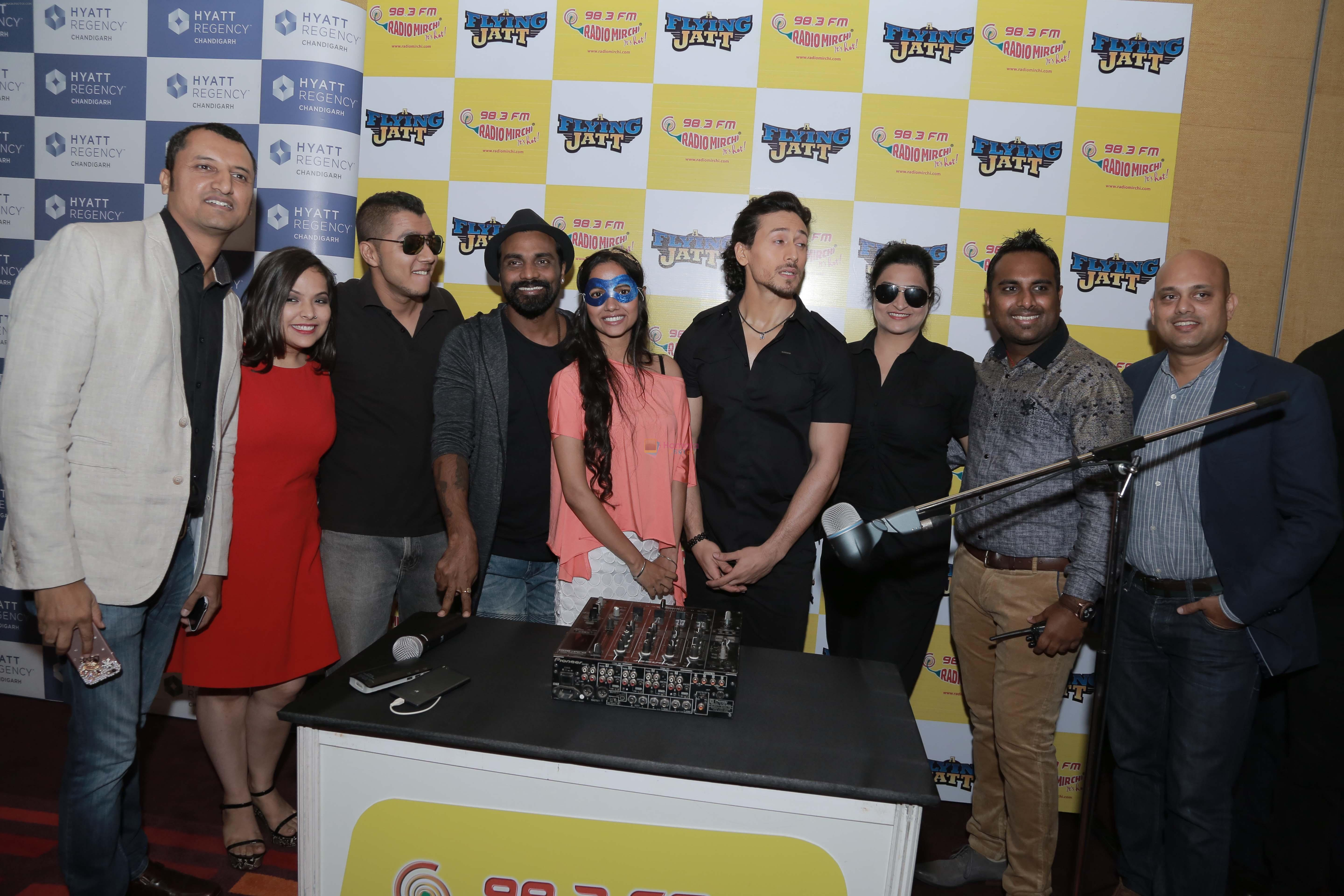 Tiger Shroff, Remo D Souza at the release of Mirchi 98.3 FM launches in Chandigarh on 12th Aug 2016