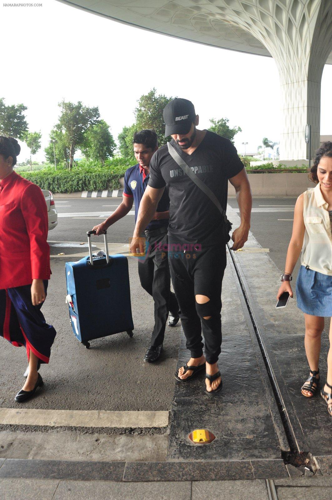 John Abraham snapped at airport in Mumbai on 14th Aug 2016