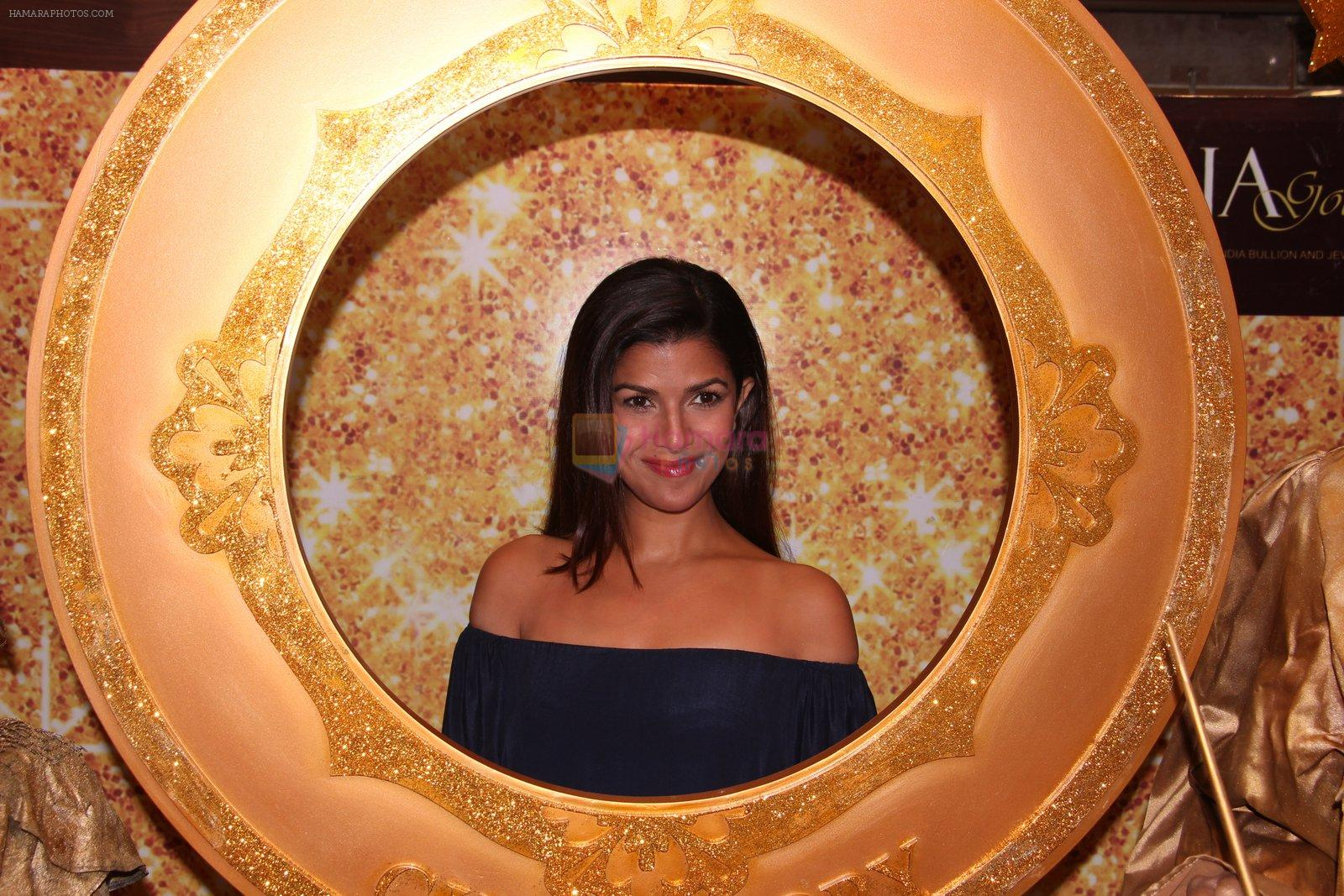Nimrat Kaur during the launch of India's first customized gold coin store IBJA Gold, in Mumbai on 7th Sept 2016