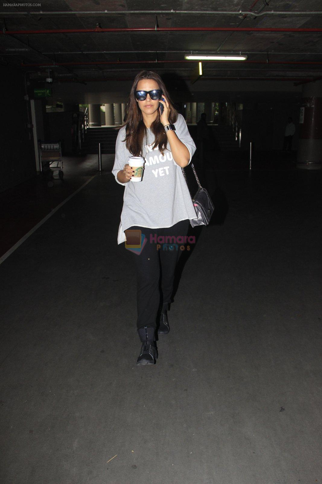 Neha Dhupia snapped at airport on 16th Oct 2016