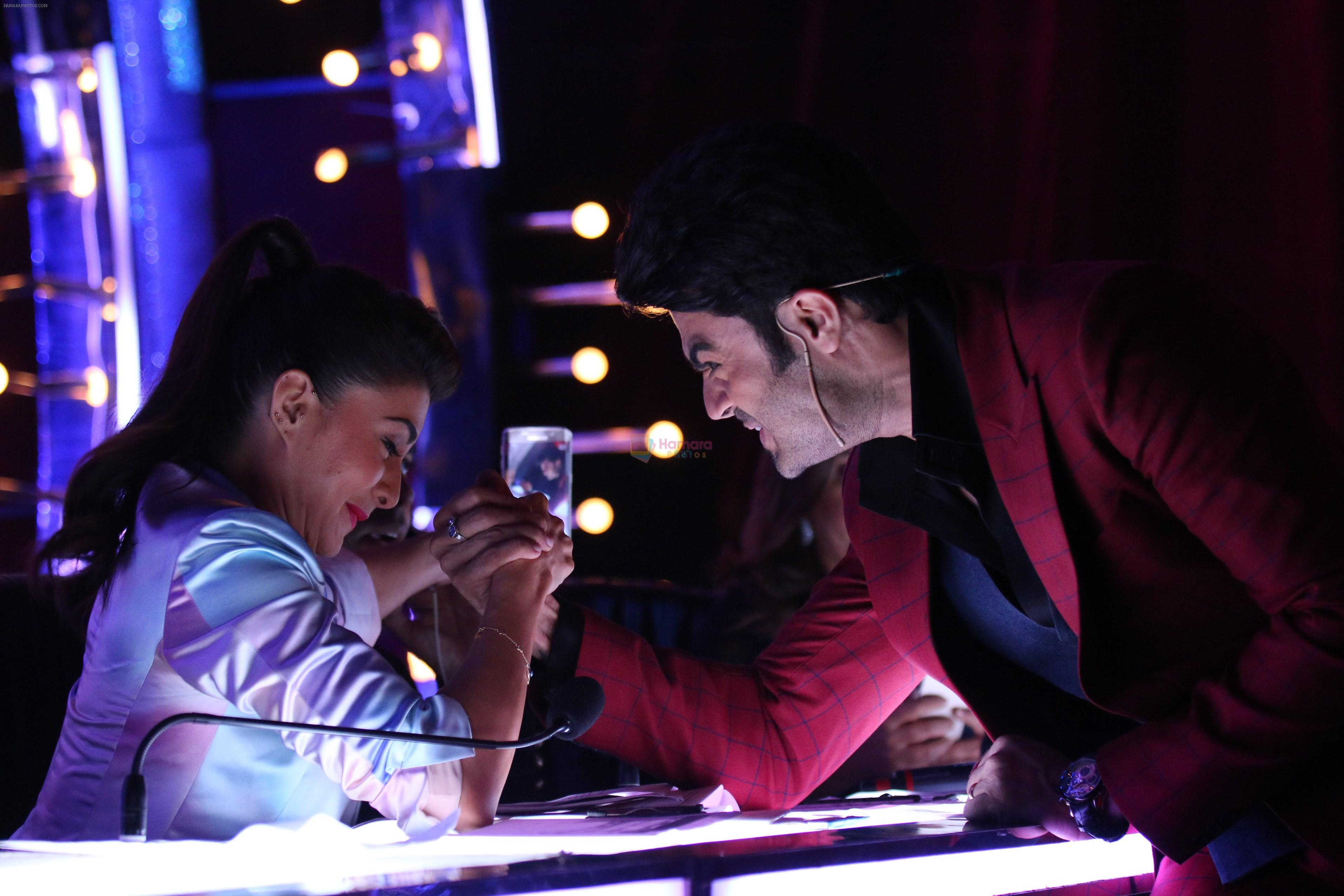 Jacqueline Fernandez & Manish Paul arm wrestling competition on the sets of Jhalak Dikhhla Jaa
