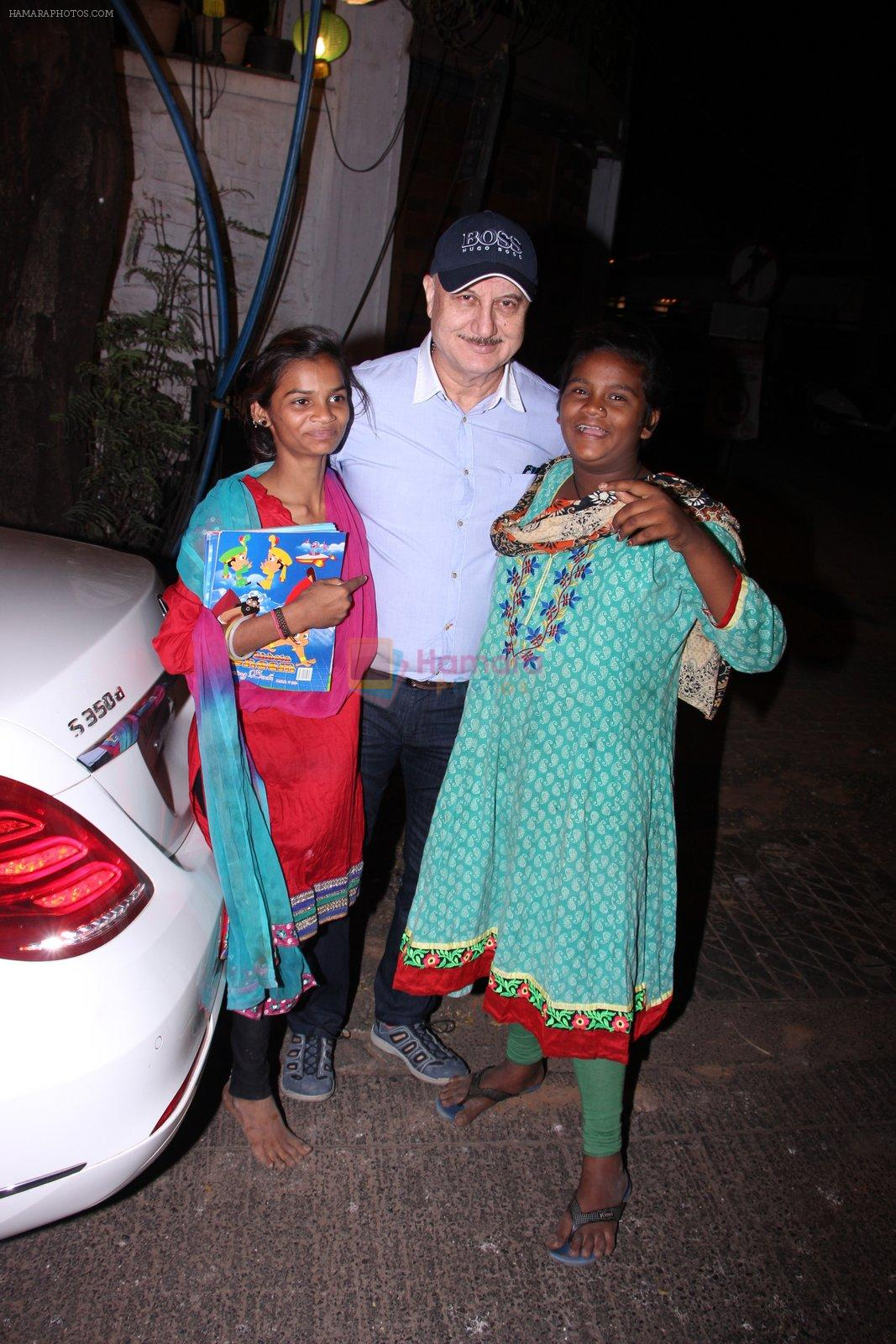 Anupam Kher snapepd with street kids on 30th Dec 2016