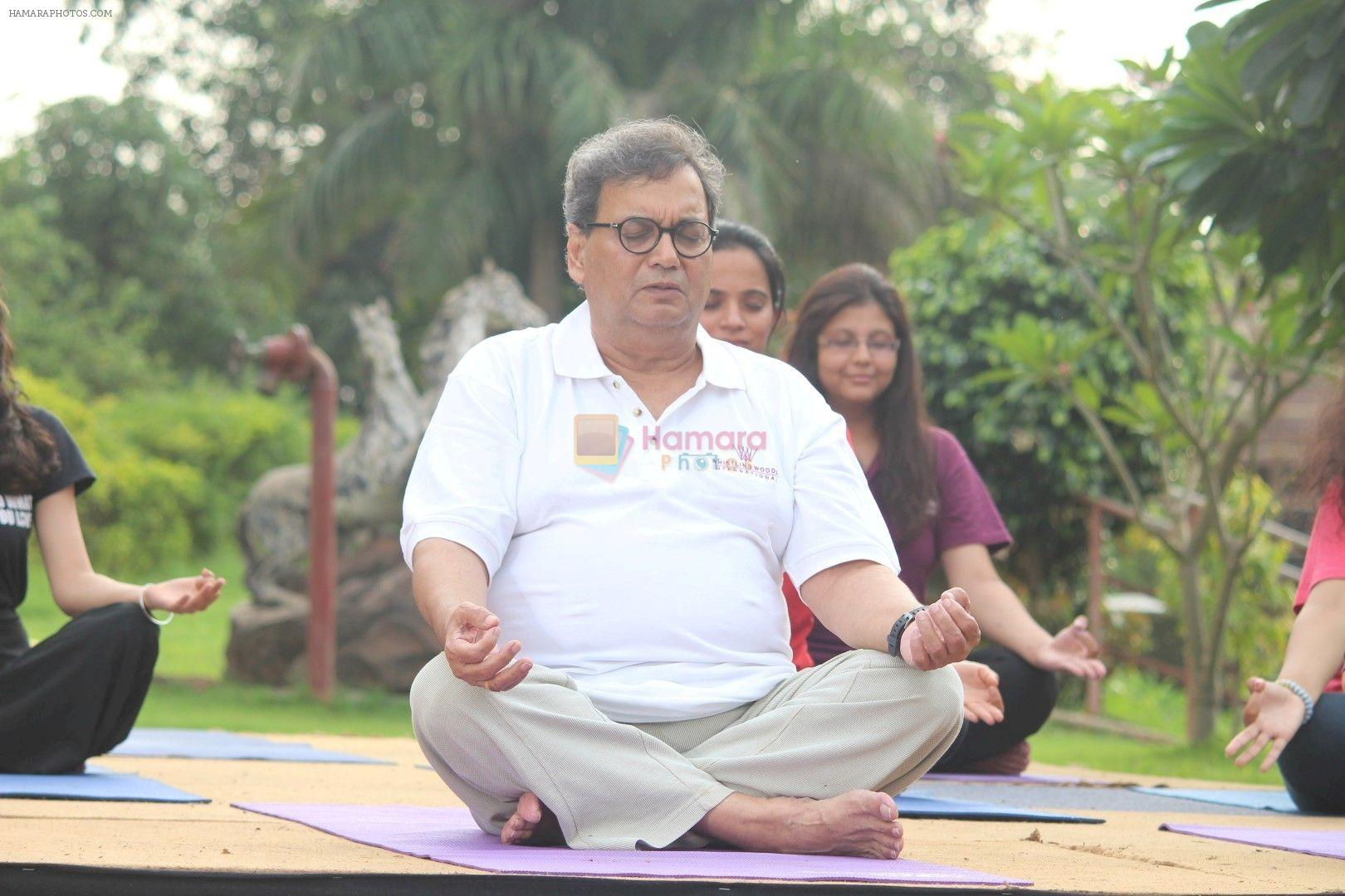 Subhash Ghai doing yoga practice along with his daughter and grandchildren at Whistling Woods International on 15th June 2017