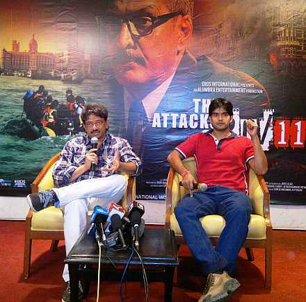 Ram Gopal Varma and Sanjeev Jaiswal at a PC for The Attacks of 26-11 to introduce Sanjeev to the media