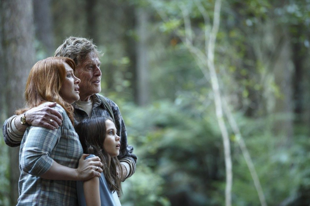 Robert Redford, Bryce Dallas Howard, and Oona Laurence in Pete's Dragon